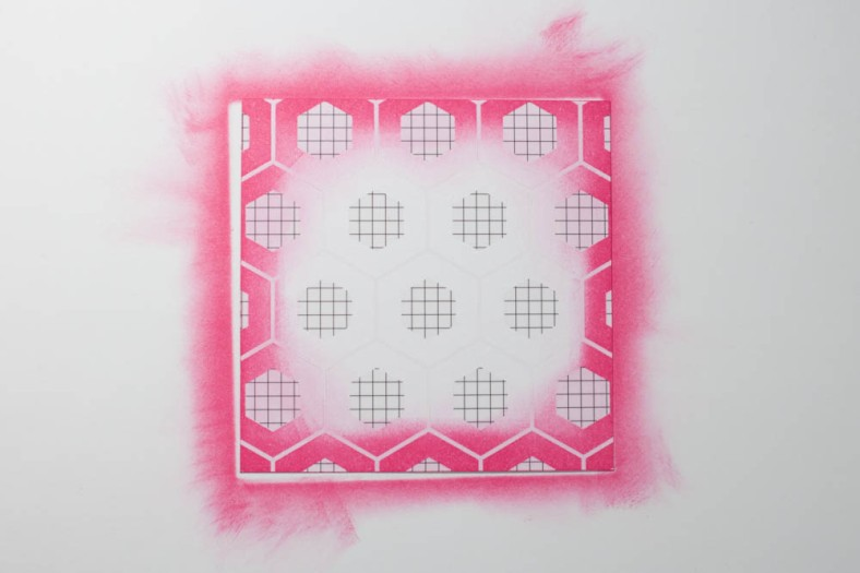 Heidi Swapp Color Magic cardstock features patterns in an ink-resistant material. After inking, I removed the excess with a paper towel.